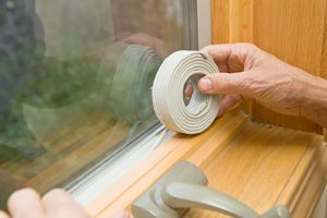 inspecting weather stripping on windows and doors for fall