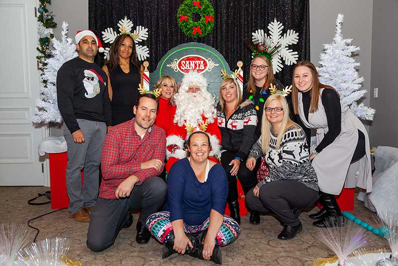 the munir group staff posing for a christmas photo